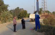 بالصور حملة لطلاء أعمدة الإنارة بشوارع قرية فانوس بمركز طامية الفيوم