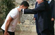 بالفيديو ..تعرف علي وعد بطل العالم لرفع الأثقال للرئيس عبد الفتاح السيسي.